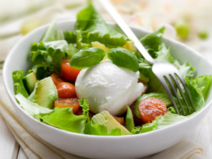 whole mozzarella with green salad,tomatoes and avocado
